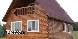 Дом из бруса с балконом