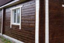 Защита и отделка брусового дома: чем покрасить стены