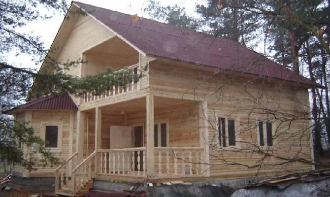 Дом из бруса с эркером и террасой