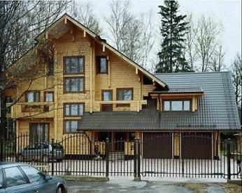 Дом с гаражом из бруса в 2 этажа