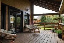 Стильный дом из профилированного бруса с верандой