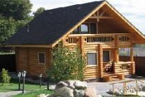 Сколько стоит построить дом из оцилиндрованного бревна: затраты