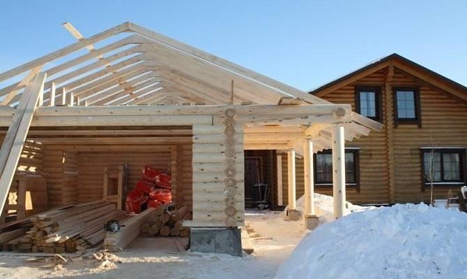 Строительство гаража из оцилиндрованного бревна